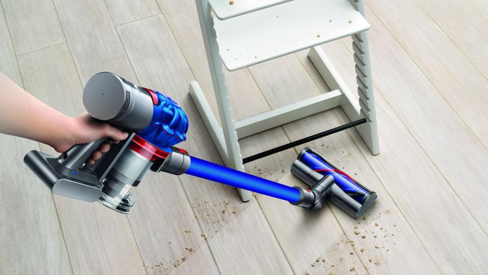 Dyson V7 Motorhead cordless vacuum cleaning a spill.