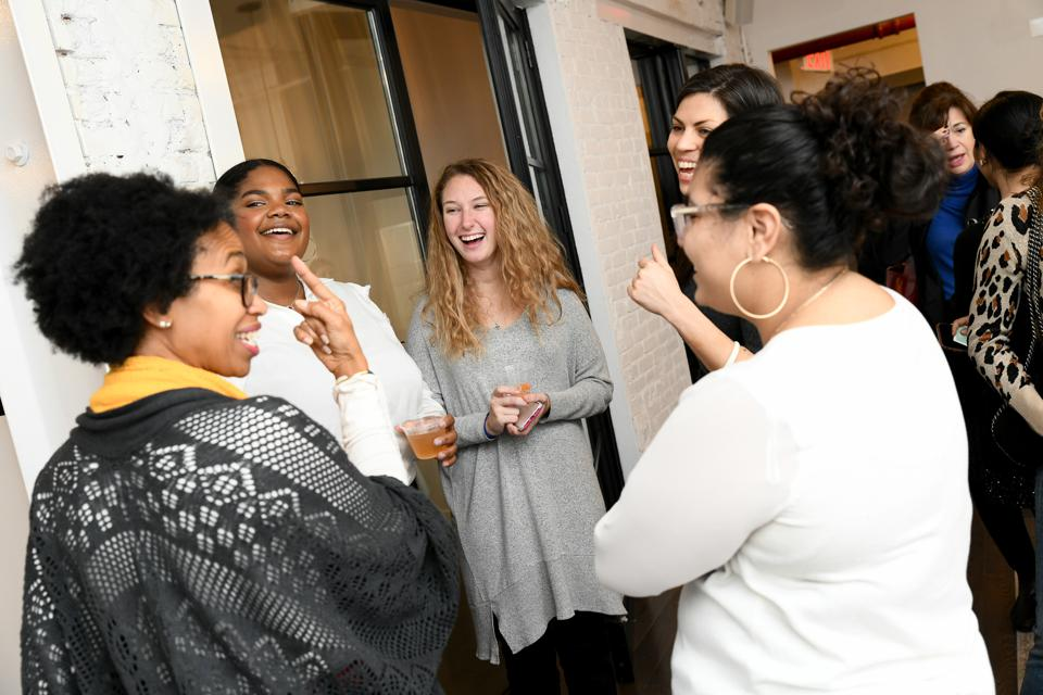 Inviting others to sit at the table, making room for more women.