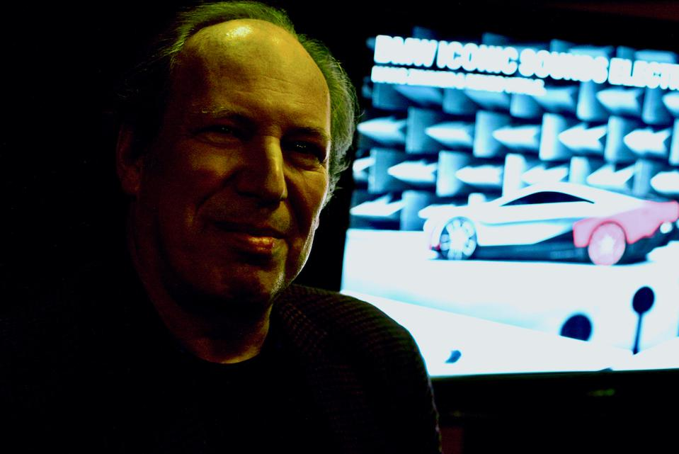 Hans Zimmer with background TV image of BMW car