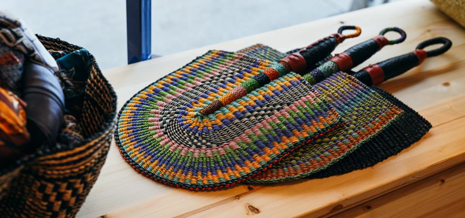 Handwoven fans on a shelf at the Goodee pop-up shop at the Whitney Museum in New York City.
