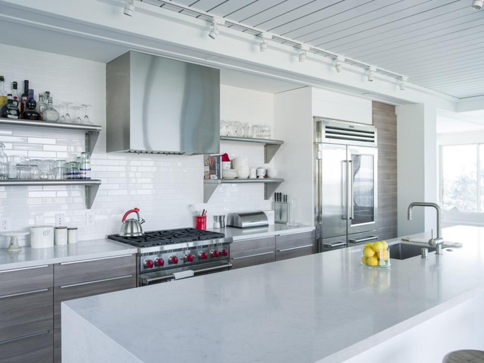 The countertops in this Bonsall, CA house were manufactured by Ceasarstone®.