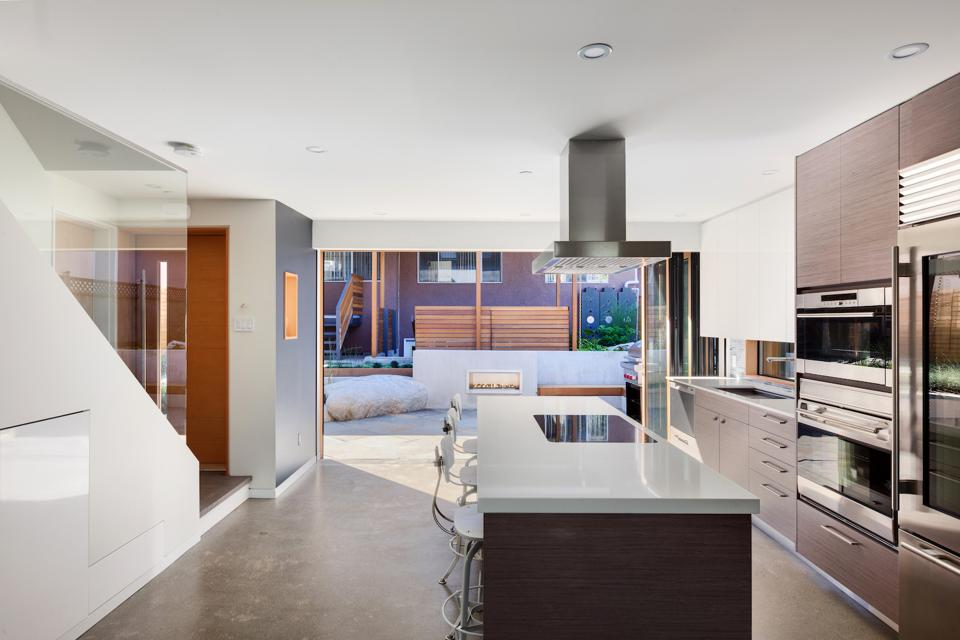 The countertops in this ADU in Vancouver, BC are quartz. The designer/builder was by Lanefab.