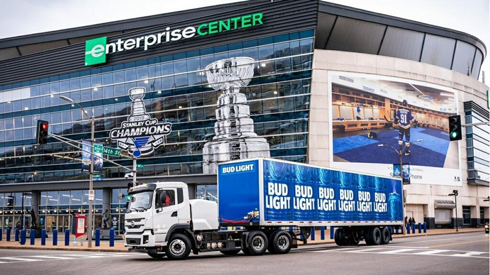 A battery-electric powered Anheuser-Busch truck delivers beverages to Enterprise Center
