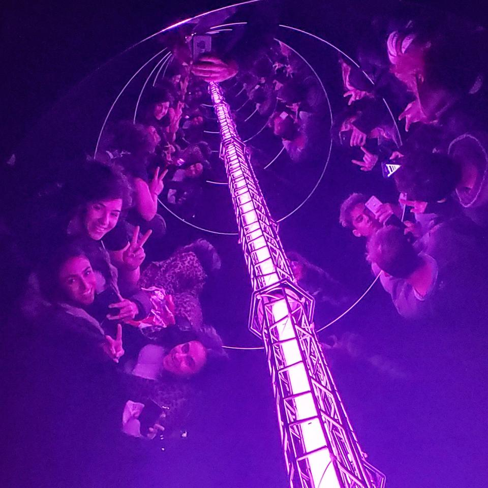 On the left, three friends - Julie, Sarah and Sara - pose for selfies while looking into Kusma's ″Ladder to Heaven and Souls″ at the David Zwirner Gallery