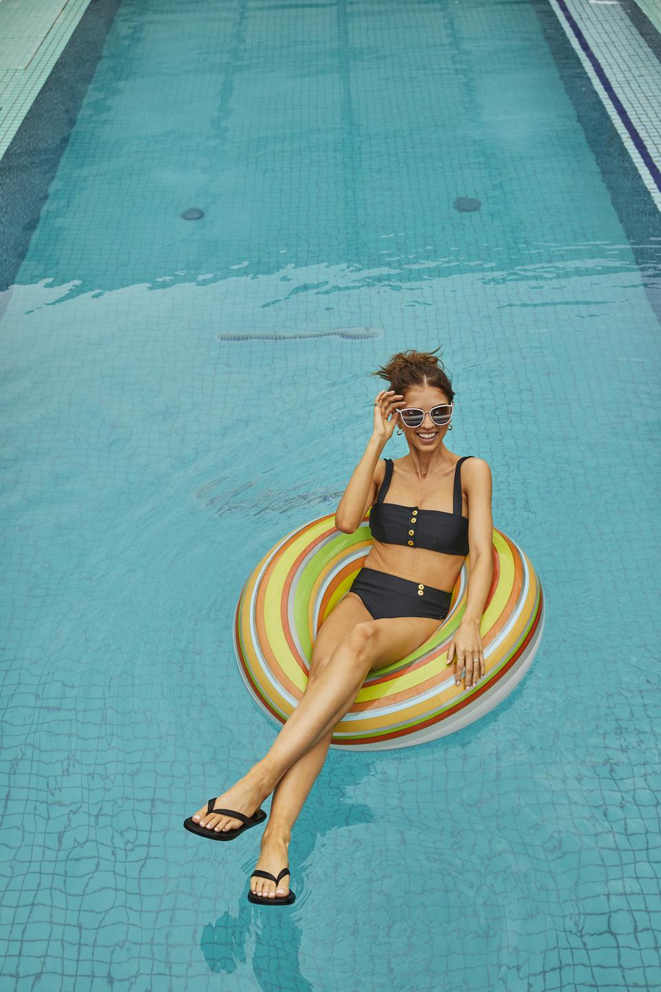 woman in pool with flip flops