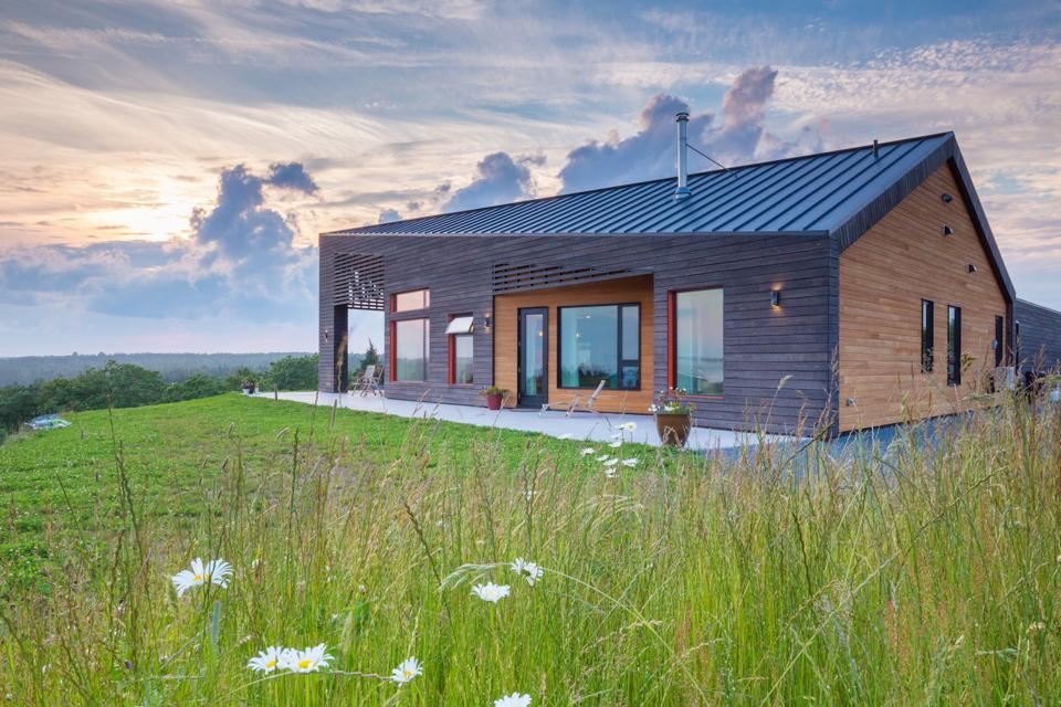 Small wood house in Nova Scotia designed for net zero energy efficiency.