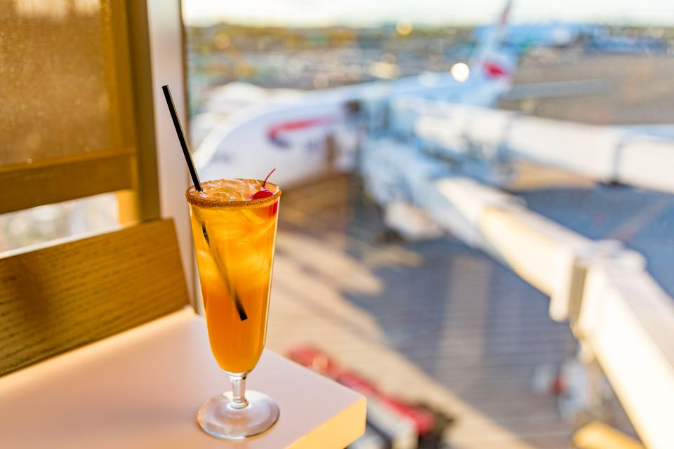 BOSTON, MA - An ″Apple Bottom″ craft cocktail by head bartender Katie Clements at the British Airways Lounge at Logan Airport.