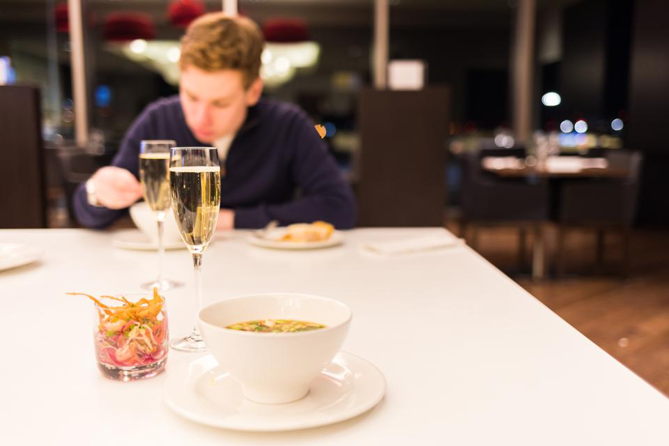 BOSTON, MA - A guest dines at the BA Lounge in Boston's Logan before a flight to Heathrow.