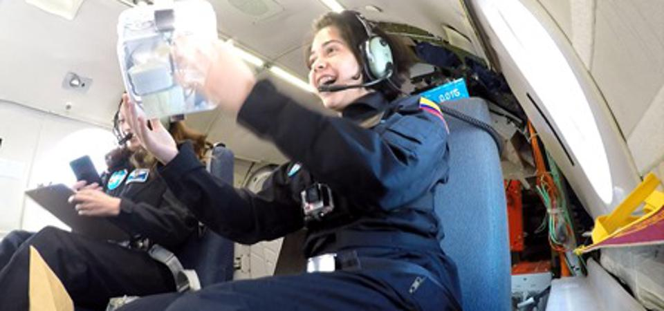 Ivanna Hernandez, 16, from Colombia experiences microgravity on a parabolic flight of Canada's National Research Council (NRC) Falcon-20 aircraft, as part of the  PoSSUM microgravity campaign.