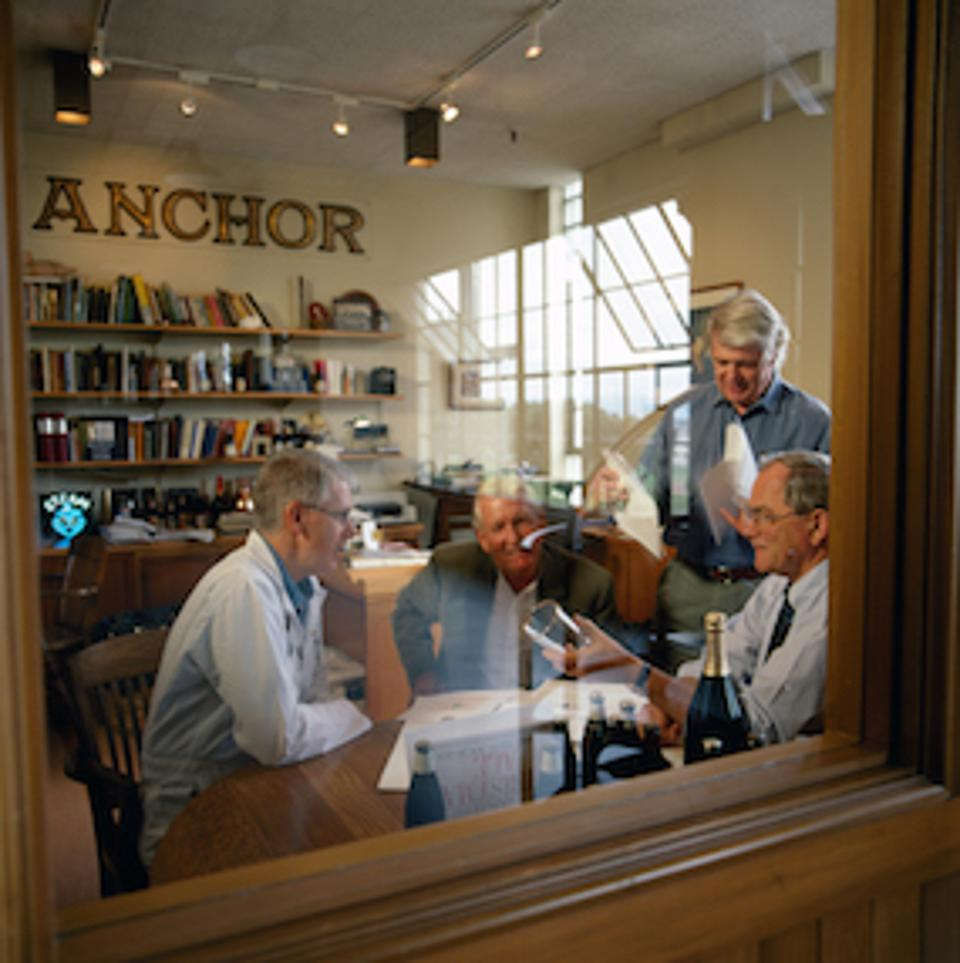 The original group - Dave Burkhart, Jim Stitt, Jack Martin, and Fritz Maytag  - of the brewery design team meets in 2002 to discuss the Christmas label.