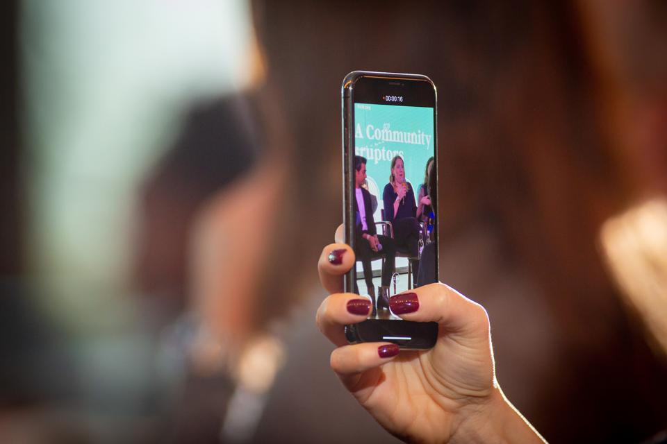 A CMO Summit Europe attendee captures footage from an Under 30 panel in London on Nov. 23.