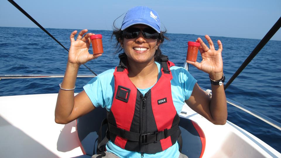 Marine biologist Dr. Asha de Vos with samples of blue whale poo collected in the waters off southern Sri Lanka.