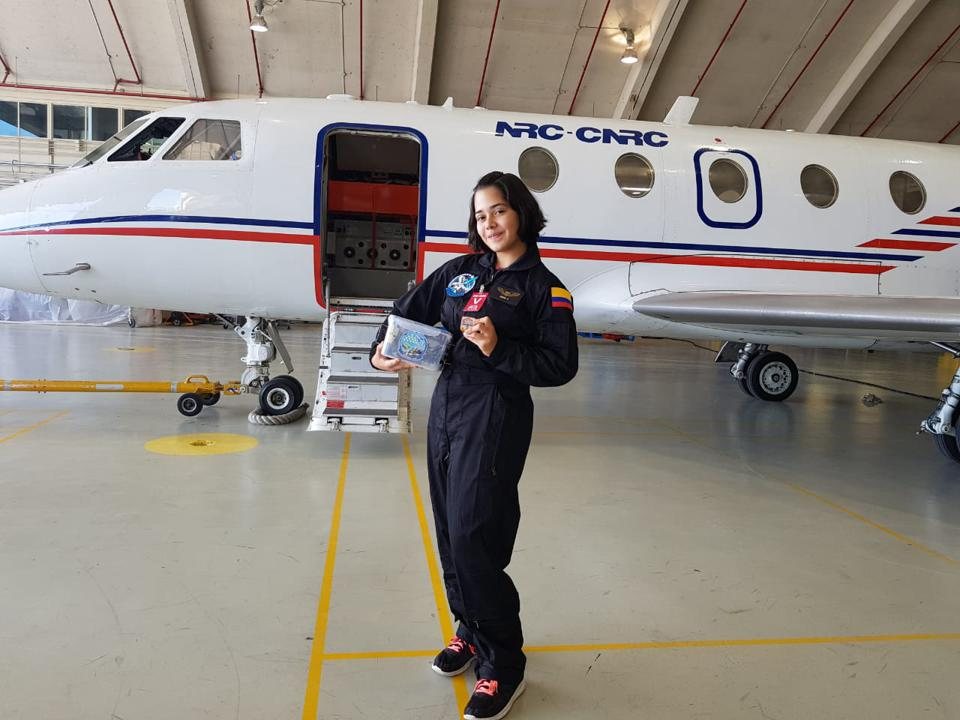 Aspiring Colombian astronaut Ivanna Hernández, 16, in Canada, holding two student space experiments from Colombia, her own and one from students in La Guajira, Colombia.