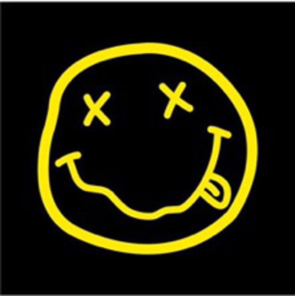Nirvana yellow outline smiley face with x's for eyes and tongue hanging out