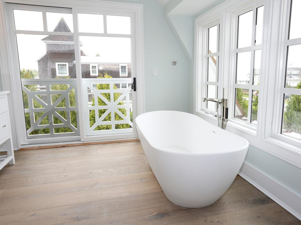 Unlike most solid wood, this engineered wood is durable in a bathroom.