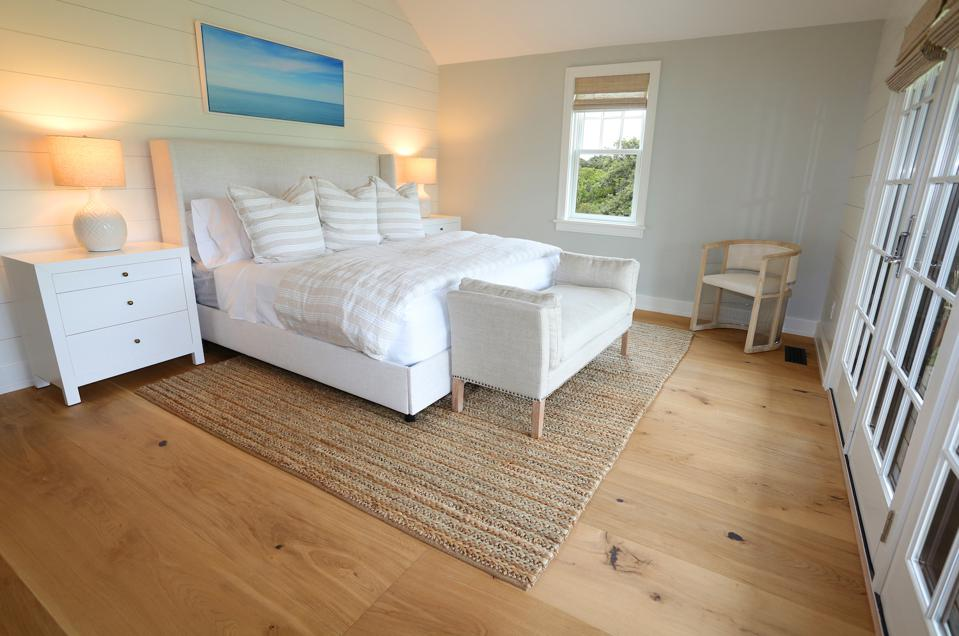 The engineered wood is carried throughout this house, including the bedroom.