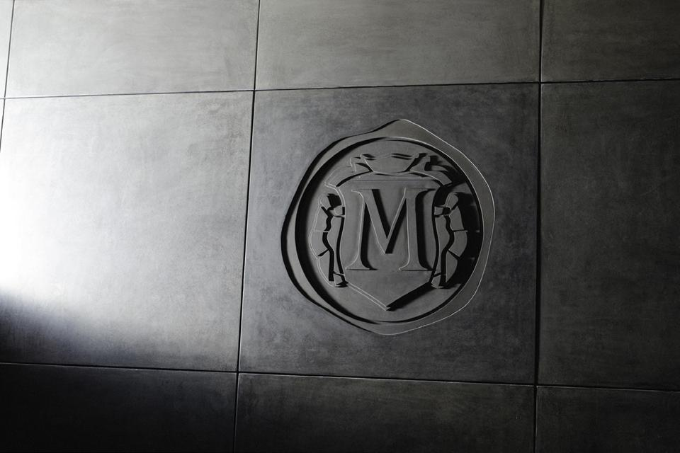 Masseto Logo on Wall of Winery