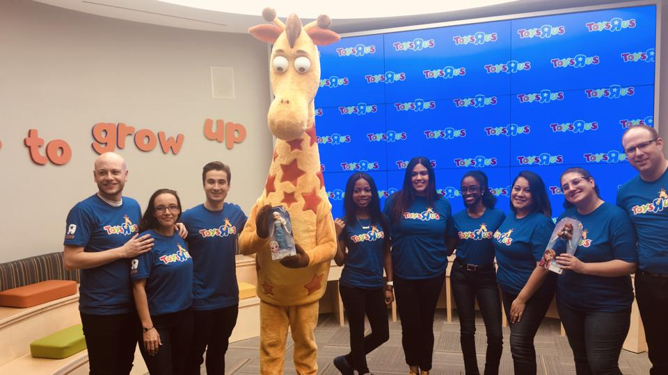 Toys R Us employees at the new store in Paramus, N.J., and Geoffrey, the Toys R Us mascot.