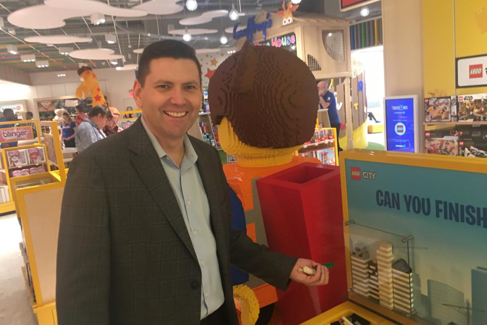 Jamie Uitdenhowen, president of the joint retail venture behind the new Toys R Us stores, in the Lego section of the new Paramus store.