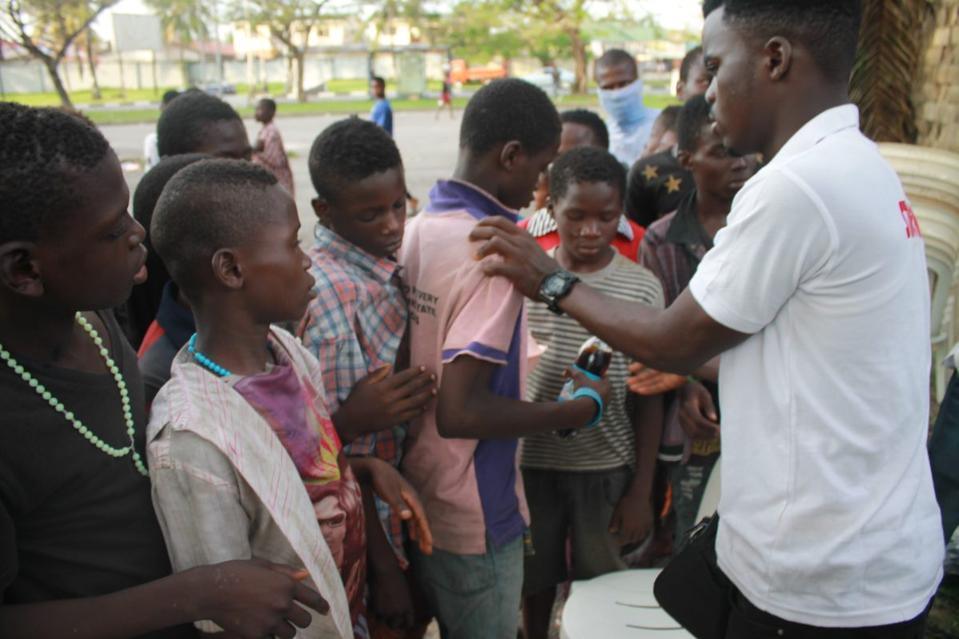 James Okina with street children