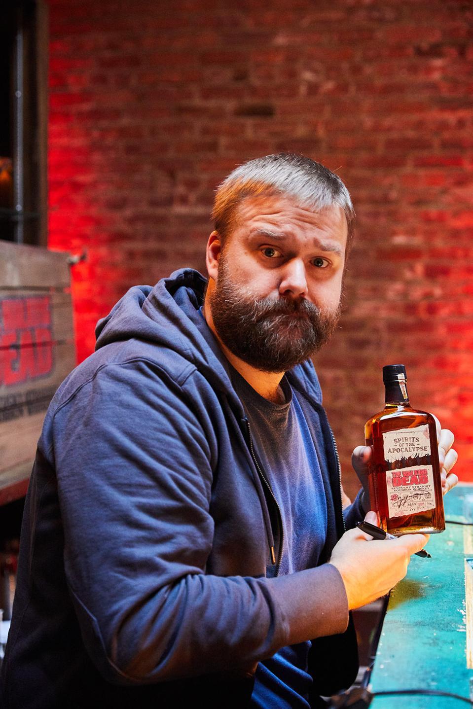 Walking Dead creator Robert Kirkman with a bottle of Walking Dead Kentucky Bourbon