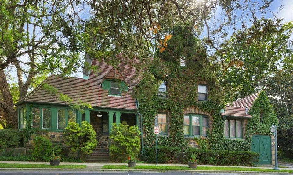 A green Tudor house.