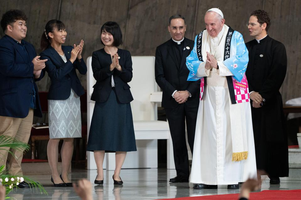 Pope Francis receives a traditional Japanese shirt.