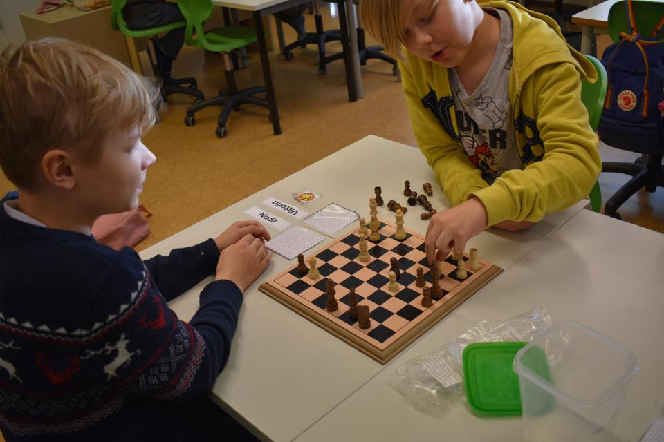 In Finland, students play actual games such as chess to learn essential technology skills.