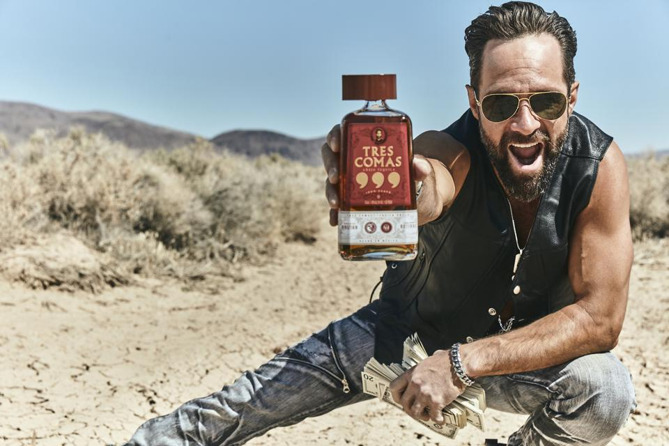 Russ Hanneman (played by Chris Diamantopoulos) holds Tres Comas tequila from ″Silicon Valley.″