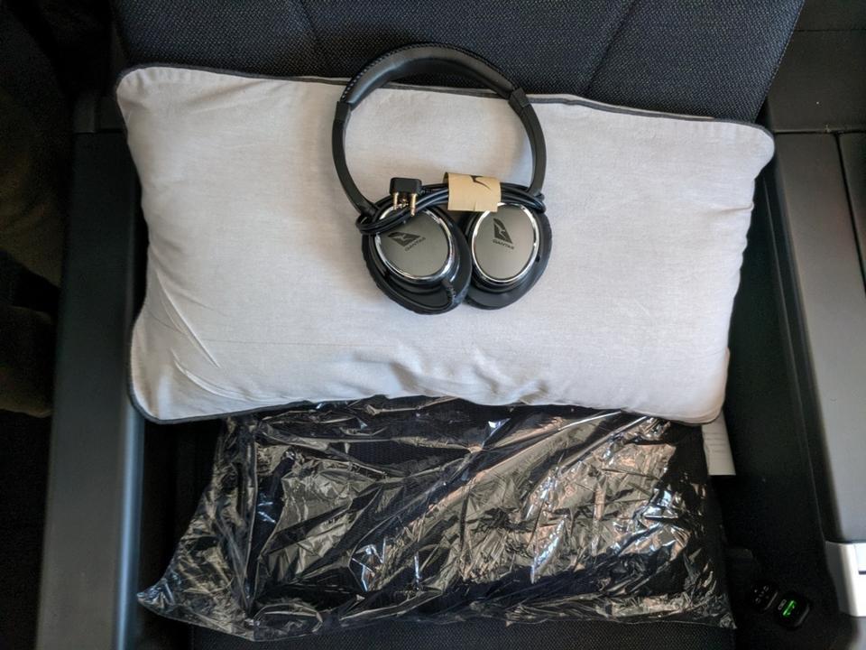 Qantas quilt, headphones and pillow