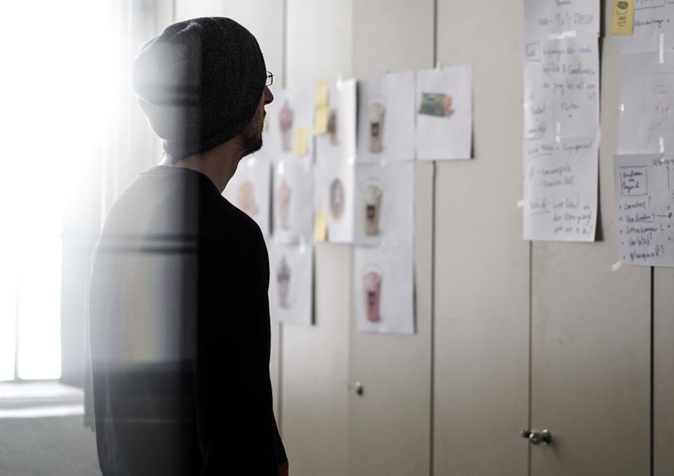 Man in brainstorm meeting.