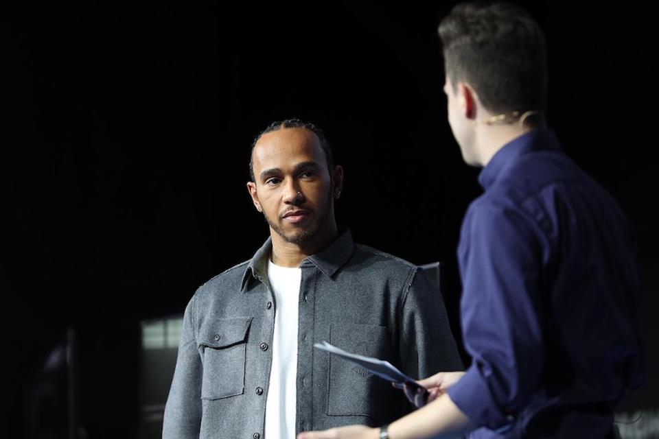 The 'Maestro' Lewis Hamilton appears on stage to speak with participants.