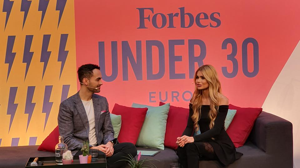 Forbes Europe Editor Alex Wood and fitness influencer and entrepreneur Pamela Reif speaking at the Forbes Under 30 Summit Europe in Berlin.