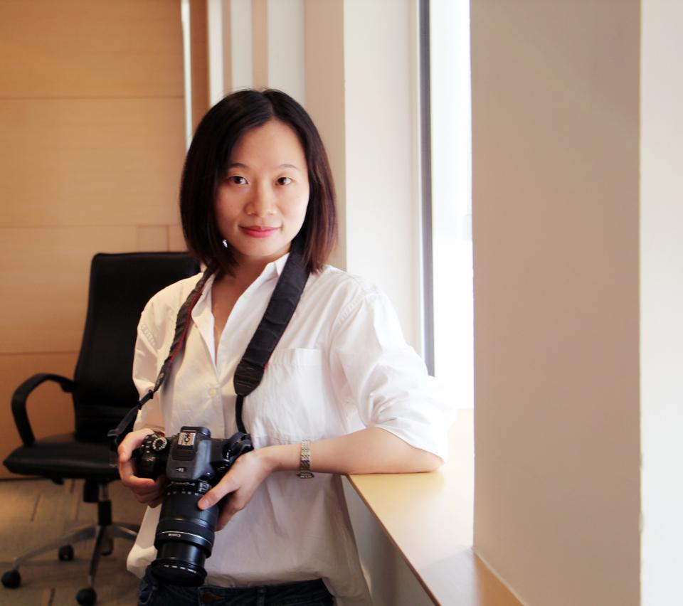 Journalist Sophia Xueqin Huang with camera