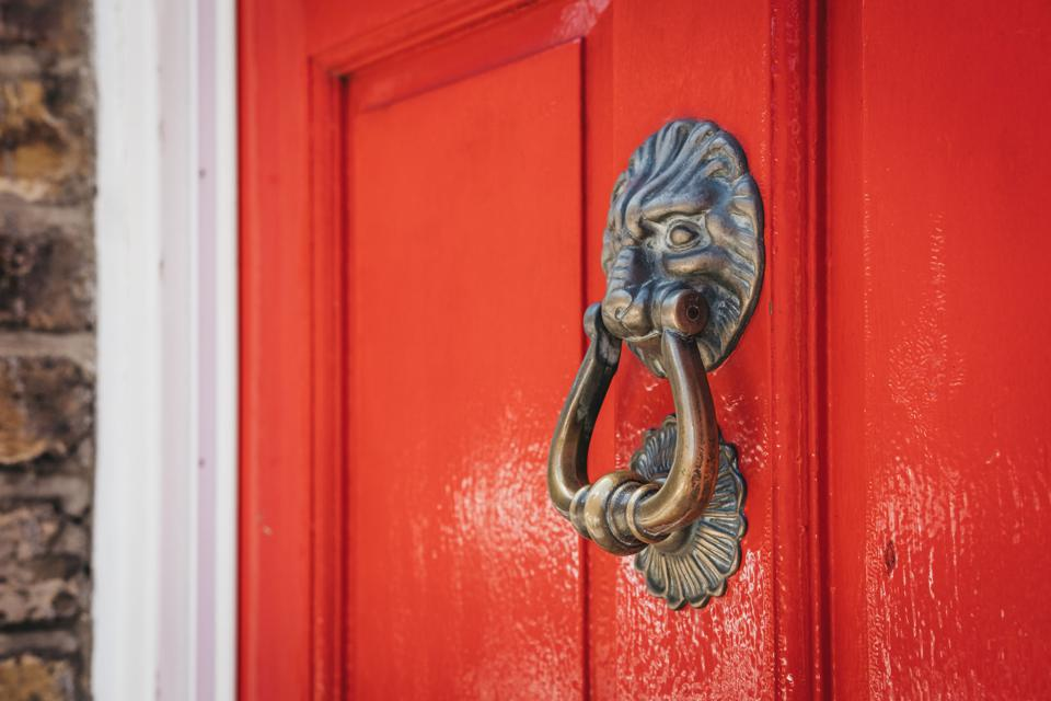A red door with lion knocker.