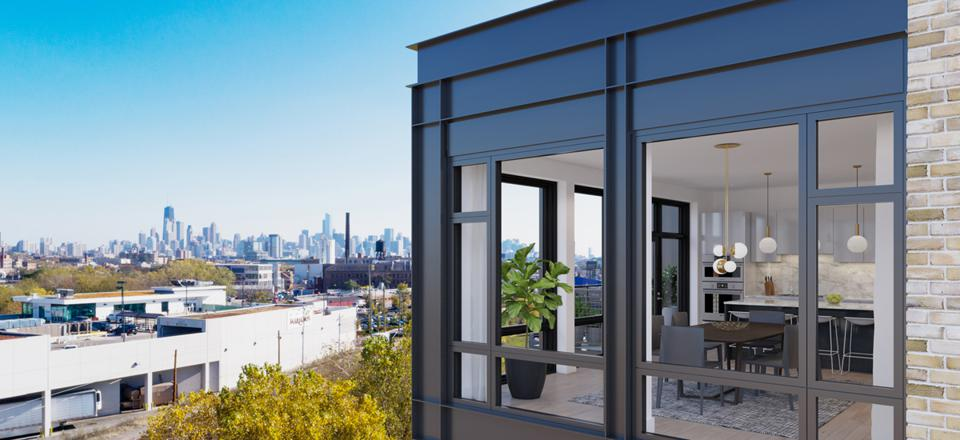 For the new Triangle Square in Chicago's East Bucktown neighborhood, developers Belgravia Group referenced the area's industrial past by choosing brick and black trim on the windows and balconies.