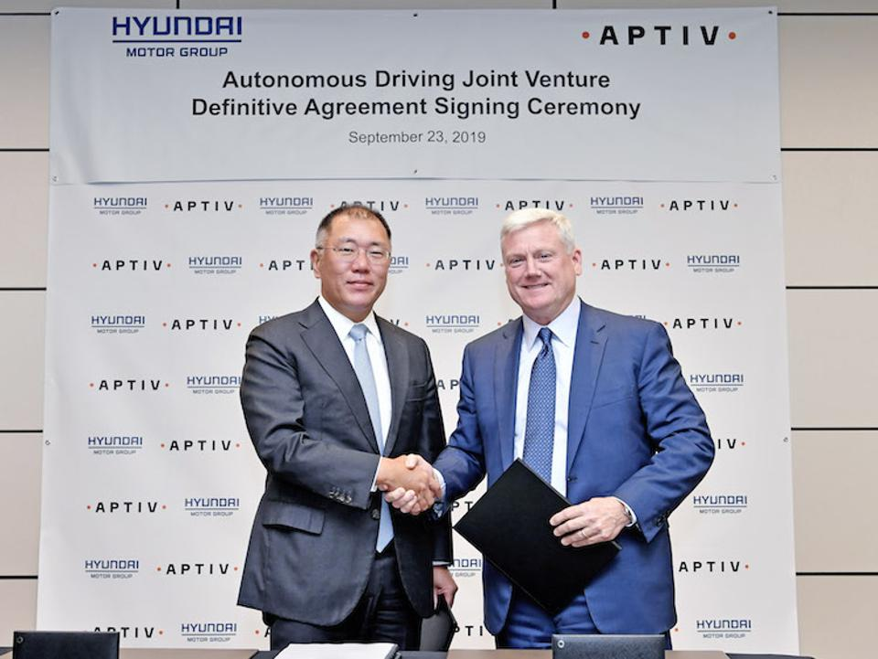The two executives shook hands on a joint venture to create autonomous vehicle systems.