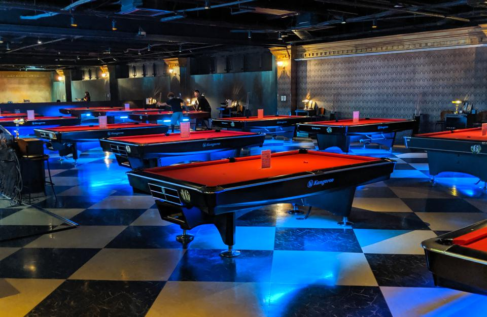 Well-lit pool tables