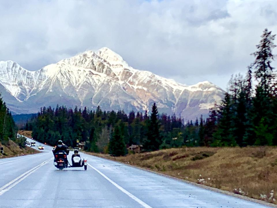Riding in a sidecar in the Canadian Rockies.