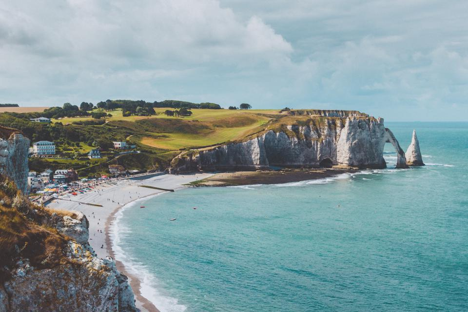 Etretat's white cliffs, including the Porte d'Aval arch and L'Aiguille (the Needle).