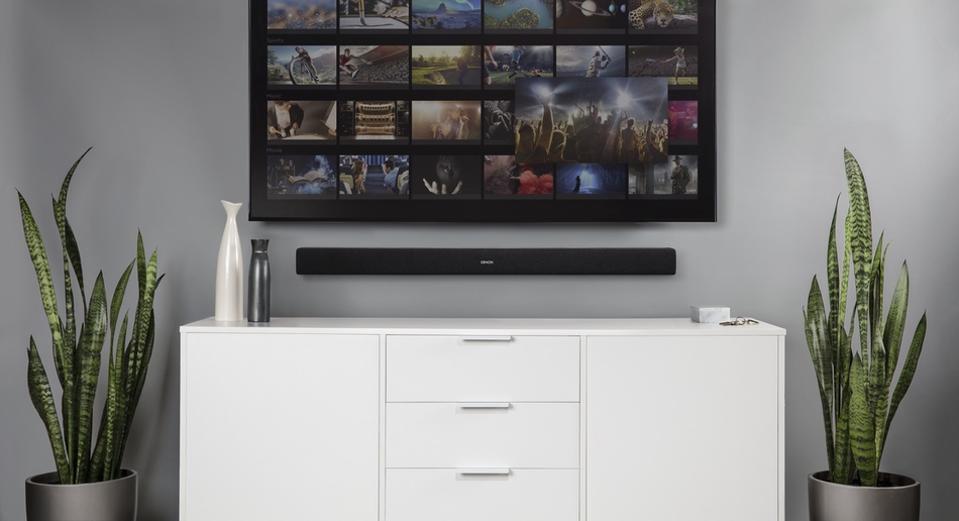Denon DHT-S216 soundbar below a TV