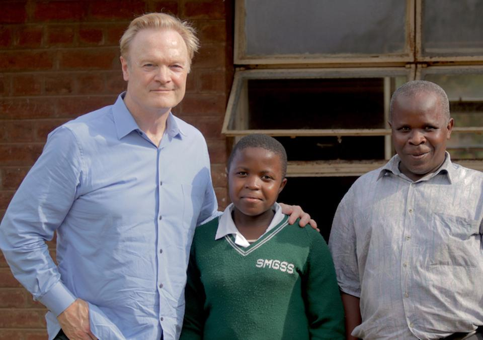 MSNBC's Lawrence O'Donnell (left) met K.I.N.D. Fund scholarship student Joyce Chisale (center) and her father, Samson Chisale, during a 2016 visit to Malawi.