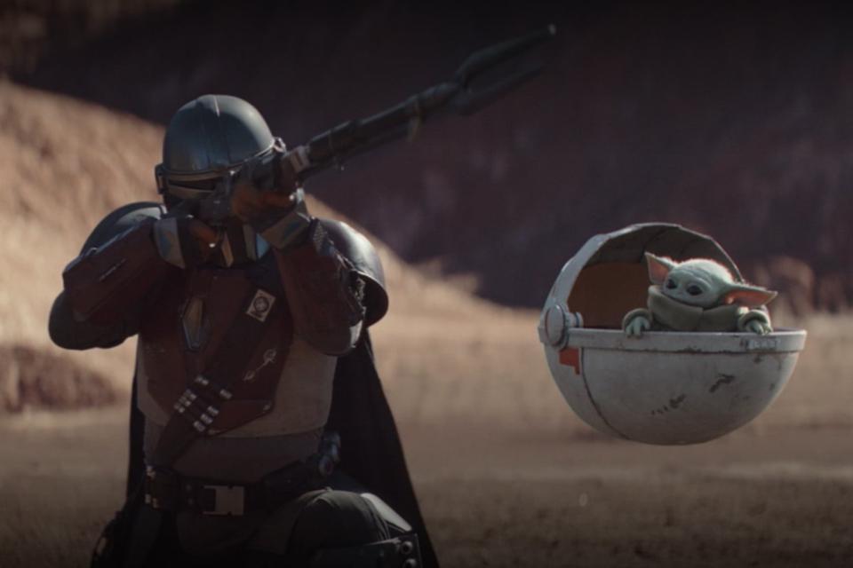 The Mandalorian with 'Baby Yoda'