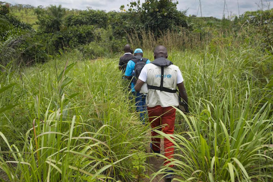 A mobile UNICEF vaccination team walks to a remote village near the Kasai River in the Democratic Republic of the Congo (DRC) on November 5, 2019.