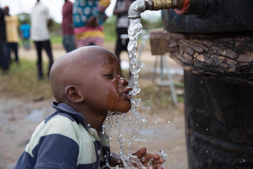A child drinks from a UNICEF-supported water point in Dondo, Mozambique, on April 4, 2019.