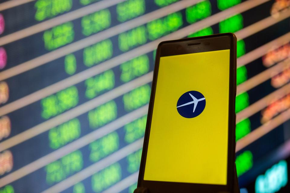 The Expedia app is seen on a smartphone...