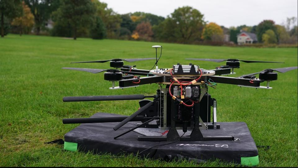Spooky Action's TeleLift ″flying cell phone tower″ tethered drone on the ground before testing in Minnesota.