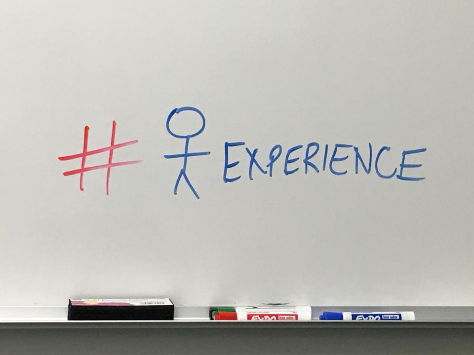 White board with ″customer experience″ written on it