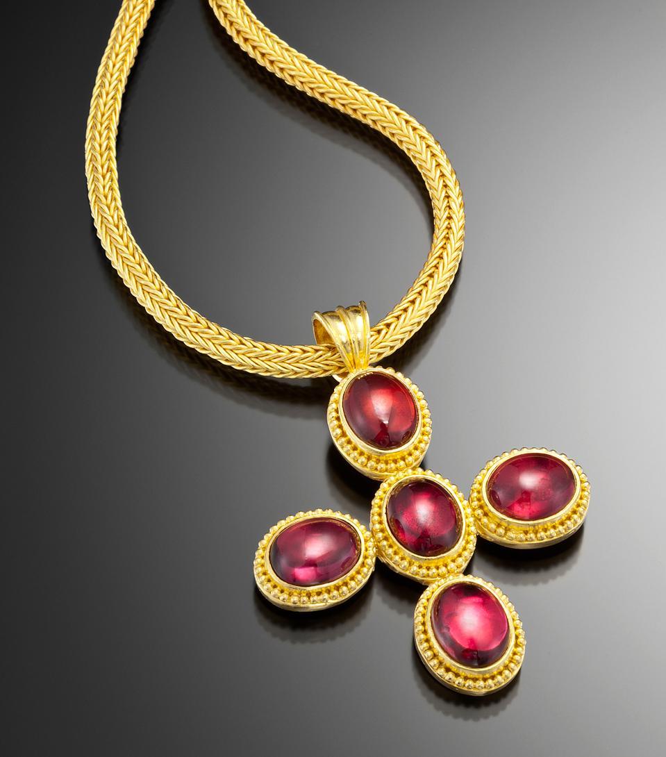 22-karat gold jewelry with rhodolite garnets