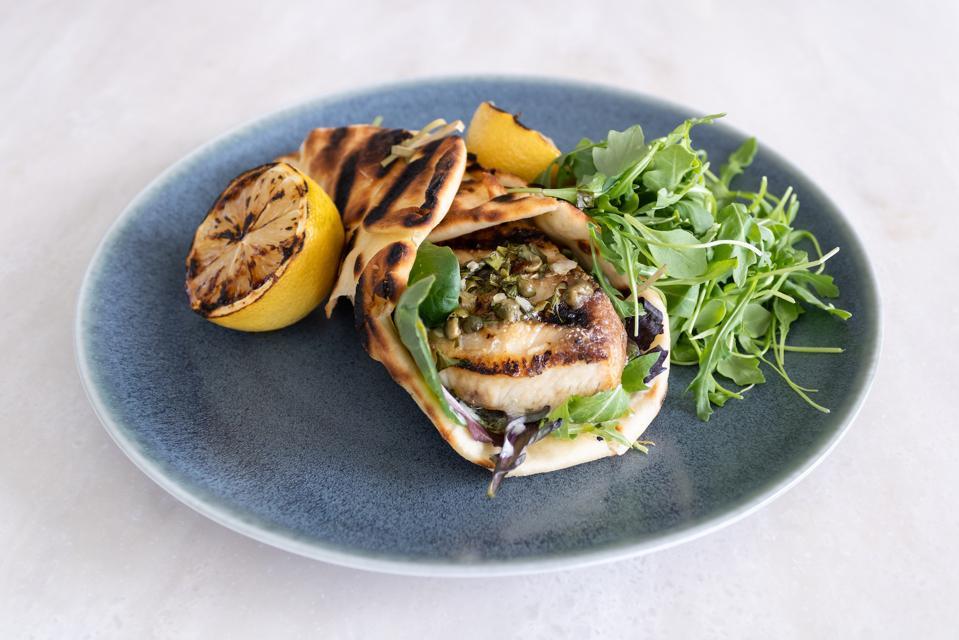 Market Fish Sandwich with crema coriandolo and grilled naan at Quiora restaurant in Waikiki